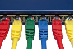 Rainbow colored connected computer network plugs Stock Photo