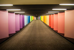 Rainbow colored corridor. Vanishing point of rainbow colored corridor at certain mall royalty free stock photo