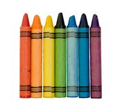 Rainbow of colored crayons Stock Photos