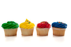 Rainbow colored cupcakes Stock Photo