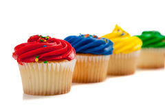Rainbow colored cupcakes Royalty Free Stock Photography