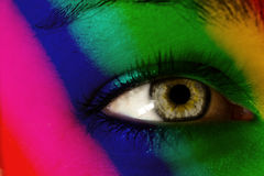 Rainbow colored female face Stock Images