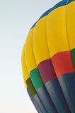 Rainbow colored hot air balloon Royalty Free Stock Image