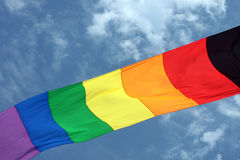 Rainbow Colored Kite Tail in a Blue Sky Stock Photos