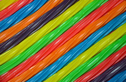 Rainbow colored licorice background Stock Image