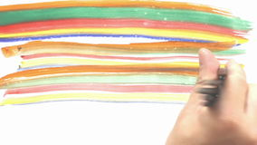 Rainbow colored paint brushes stock video footage