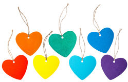 Rainbow colored paper hearts with rope stock photo