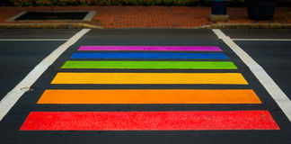 Rainbow colored pedestrian crossing in Moncton, New Brunswick. Bright, colorfully painted pedestrian crossing in city of Moncton New Brunswick, Canada.  All Royalty Free Stock Photography