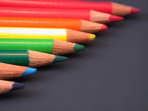 Rainbow of colored pencils. A rainbow of colored pencils, on a dark background stock photos