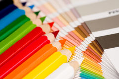 Rainbow of colored pencils. A rainbow of colored pencils with color chips Royalty Free Stock Images