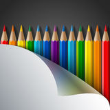 Rainbow colored pencils and realistic white paper Royalty Free Stock Photography