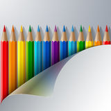 Rainbow colored pencils and realistic white paper Royalty Free Stock Images