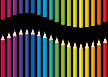 Rainbow Colored Pencils Seamless Wave Black. Colored pencils or crayons as a rainbow colored wave. Seamless background can be created in all directions.  vector Royalty Free Stock Images