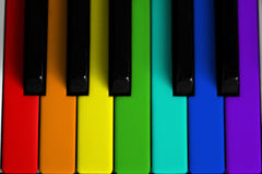 Rainbow colored piano stock image