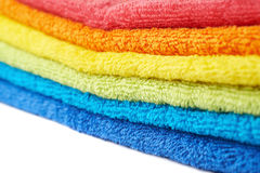 Rainbow colored pile of towels isolated Stock Image
