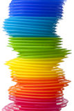 Rainbow colored plastic plates Stock Photo