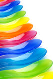 Rainbow colored plastic spoons Stock Images