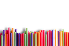 Rainbow colored plastic straws background pattern Stock Photo