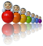 Rainbow colored roly-poly toys with reflection. Seven rainbow colored from red to purple roly-poly toys reflect on a surface Royalty Free Stock Images