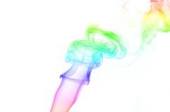 Rainbow colored smoke. Swirl of smoke on a white background Royalty Free Stock Photography