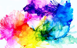 Rainbow colored splashes. Colorful background hand drawn with bright inks and watercolor paints. Color splashes and splatters create uneven artistic modern Royalty Free Stock Image