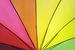 Rainbow colored summer umbrella pattern. For background Royalty Free Stock Photo
