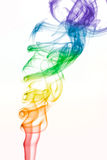 Rainbow colored swirling smoke pattern on white Stock Photography