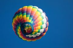 Rainbow Colored  Teardrop Shaped Hot Air Balloon Isolated with Blue Sky Background. Rainbow colored tear drop shaped hot air and balloon basket against cloudless Stock Photography