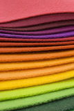 Rainbow colored textile layers. Rainbow colored textiles in horizontal layers Stock Photo