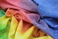 Rainbow Colored Tie Dyed Fabric. Cloth textures on rainbow fabric, abstract textures on cotton. Retro tie dyed cotton stock photos