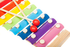 Rainbow colored toy xylophone, isolated on white Royalty Free Stock Photo