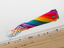 Rainbow Colored Tube Kite Flying Royalty Free Stock Photography