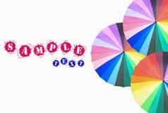 Rainbow-colored umbrella Stock Image