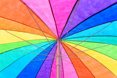 Rainbow Colored Umbrella Background Stock Images
