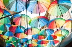 Rainbow colored umbrellas Stock Photo