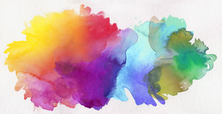 Rainbow colored watercolor paints on paper Stock Image