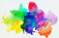 Rainbow colored watercolor paints and textures on white paper Stock Photos