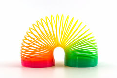 Rainbow colored wire spiral toy. Stock Photo