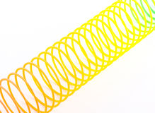 Rainbow colored wire spiral toy. Royalty Free Stock Images