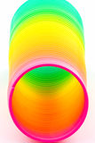 Rainbow colored wire spiral Stock Images