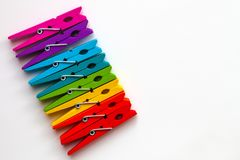 Free Rainbow Colored Wooden Clothespins On White Background With Copy Space/diversity Concept Stock Photography - 113956082