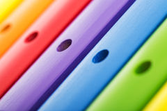 Rainbow colored wooden toy xylophone texture against white backg Royalty Free Stock Images