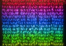 Rainbow colored xmas lights Stock Photos
