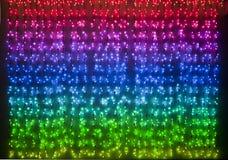 Rainbow colored xmas lights Stock Photos