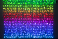 Rainbow colored xmas lights Stock Photo