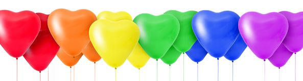 Rainbow of colorful balloons in the shape of hearts. 3D Rendering Rainbow of colorful balloons in the shape of hearts Stock Photo