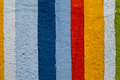 Rainbow colorful brick wall. Beautiful variety colors cement pattern background Stock Images