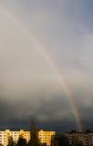 Rainbow. Colorful rainbow on the dark sky above the block of flats after the rain in spring Royalty Free Stock Photography