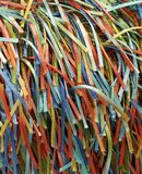 A Rainbow of Colorful Strands of Ribbons and Threads. A handcrafted fabric which creates a rainbow of colorful ribbons on woven fabric Royalty Free Stock Images