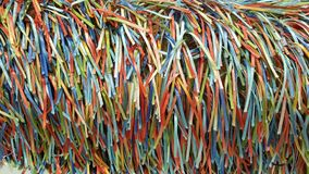 A Rainbow of Colorful Strands of Ribbons and Threads. A handcrafted fabric which creates a rainbow of colorful ribbons on woven fabric Royalty Free Stock Photos